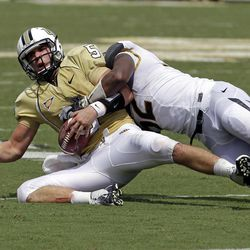 Central Florida quarterback Blake Bortles, left, is sacked by Missouri defensive lineman Michael Sam during the first half of an NCAA college football game, Saturday, Sept. 29, 2012, in Orlando, Fla.