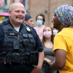 Provo Police Capt. Troy Beebe and Josianne Petit, founder of Mama & Papa Panthers, talk during a vigil on Friday, June 5, 2020, at the Provo Police Department for all those who have lost their lives to police brutality