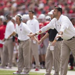 Mike Vrabel with Kerry Coombs in the background.