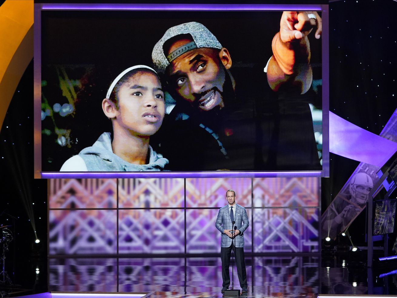 The city of Los Angeles will host a public memorial service for Kobe Bryant, his daughter Gianna and the seven others who died in a helicopter crash on Jan. 26 in Calabasas. In this photo, former NFL quarterback Peyton Manning pays tribute to Kobe Bryant and his daughter Gianna at the NFL Honors football award show Saturday, Feb. 1, 2020, in Miami. (AP Photo/David J. Phillip)