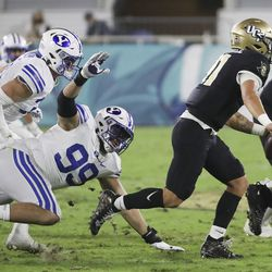 Brigham Young Cougars defensive lineman Zac Dawe (99) pressures UCF Knights quarterback Dillon Gabriel (11) during the Boca Raton Bowl in Boca Raton, Fla., on Tuesday, Dec. 22, 2020.