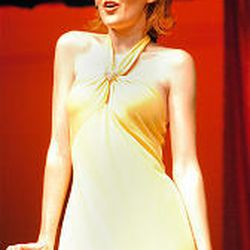 2005 Miss Murray, Camille Jensen, sings a musical number during the pageant in Murray. Local and national pageants give women a chance to do great things and change their communities, contestants say.