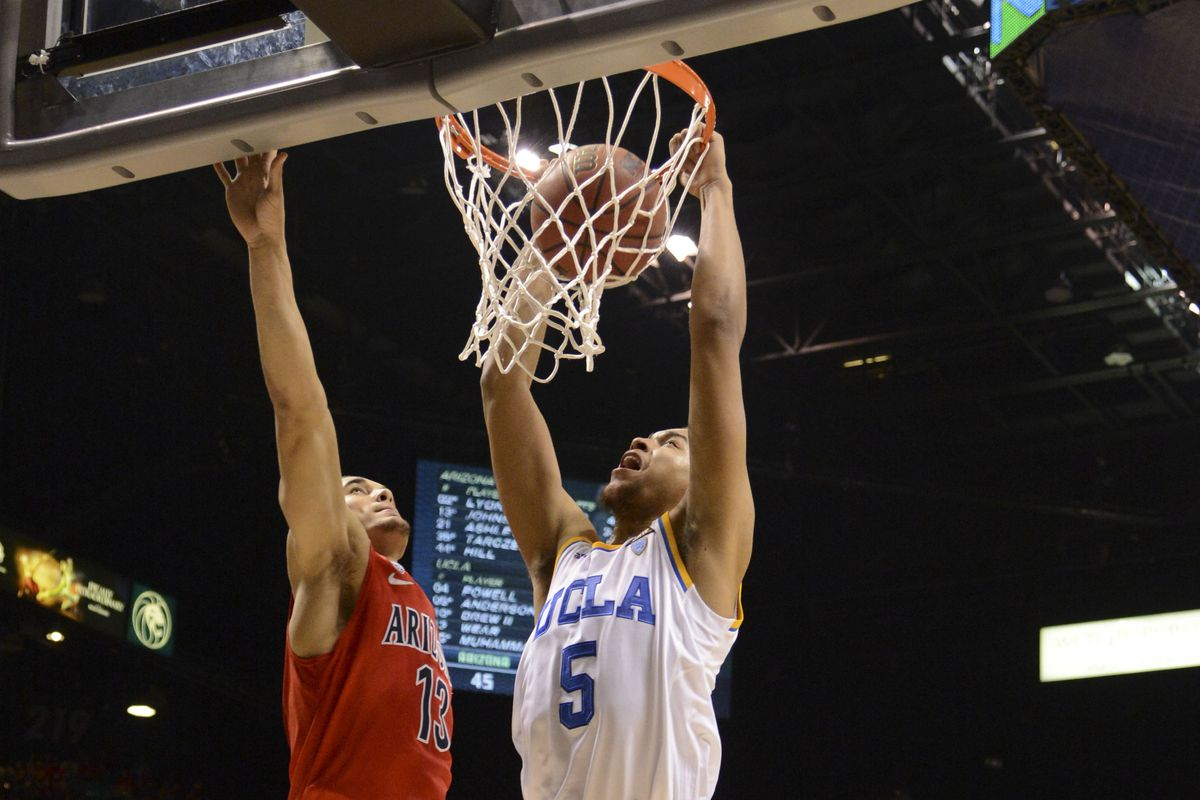 AZ's Nick Johnson(left) is good, but Kyle Anderson(dunking) rises above him in the Player of the Year race so far.