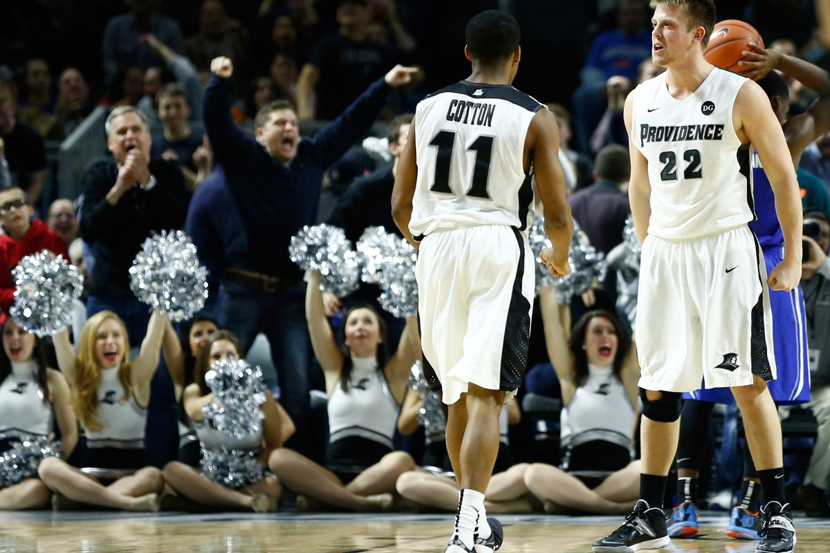 Ted Bancroft (22) and Bryce Cotton (11) celebrate after a steal and a bucket as Providence defeated Creighton 81-68.