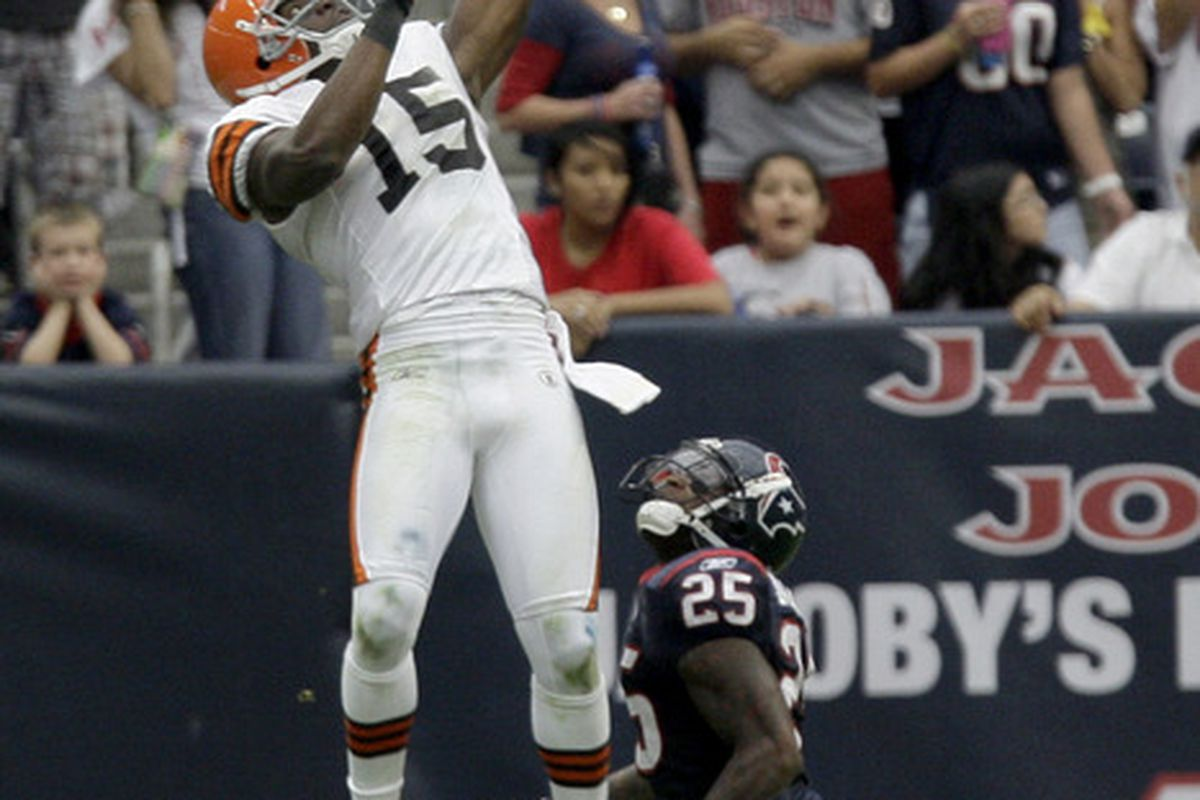 HOUSTON, TX - NOVEMBER 06: Wide receiver Greg Little #15 of the Cleveland Browns makes the catch over cornerback Kareem Jackson #25 of the Houston Texans on November 6, 2011 at Reliant Stadium in Houston, Texas. (Photo by Thomas B. Shea/Getty Images)