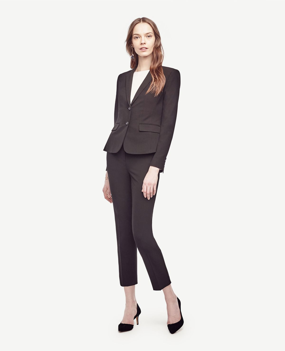 e2a6285c19 A model wearing ankle pants and a blazer