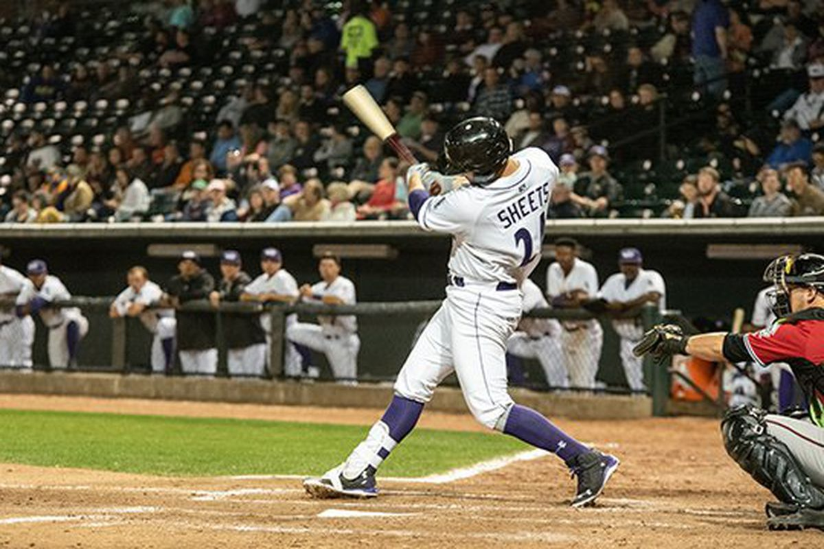 Gavin Sheets, in a Dash uniform, is in the followthrough of a big swing at the plate, viewed from his open side