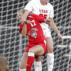Utah's Amanda Sanchez and New Mexico's Kaela Kelly fight for the ball during soccer action Thursday.