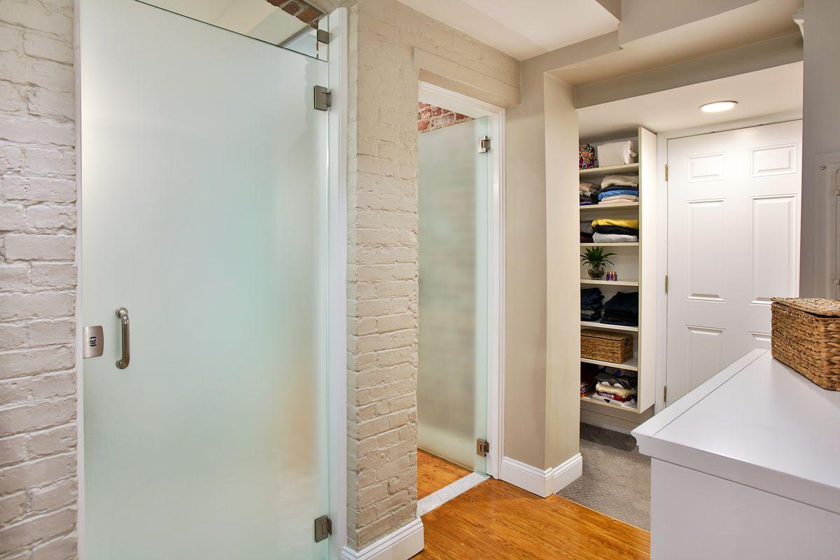 A short, narrow hallway in a condo leading to a closet.