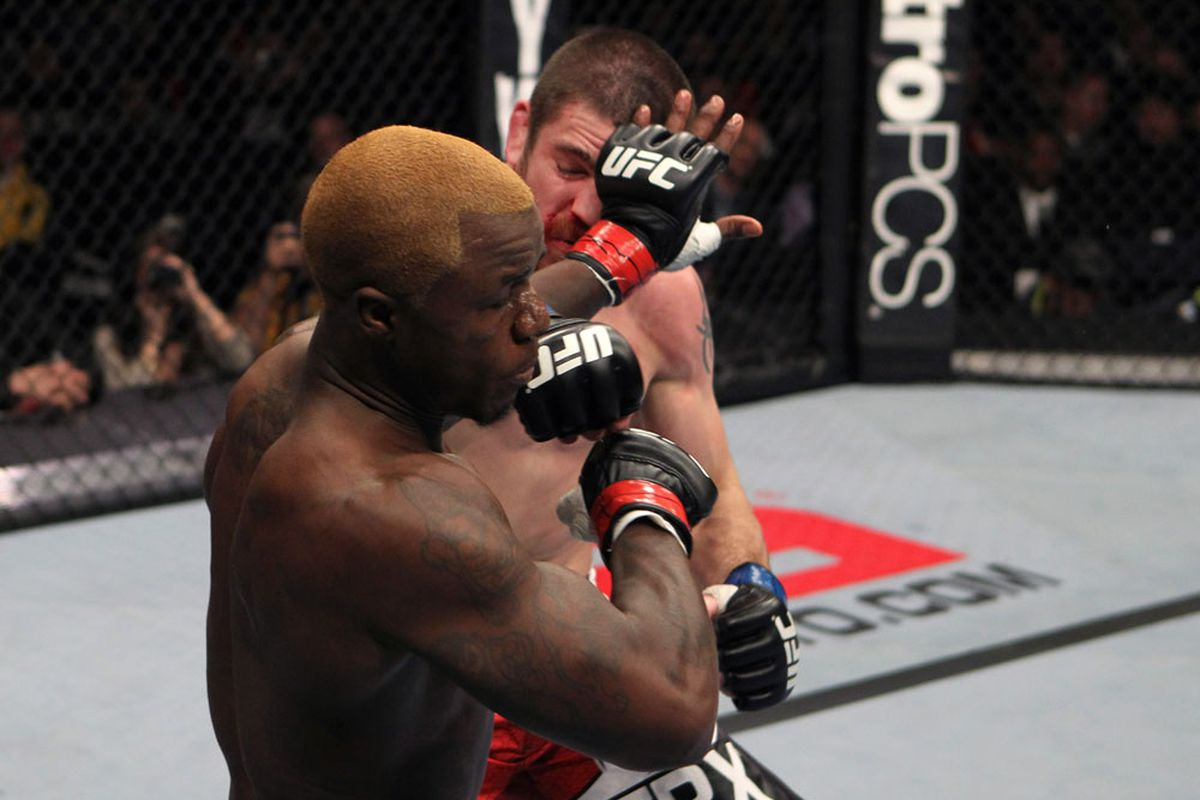 NASHVILLE, TN - JANUARY 20: (R-L) Jim Miller punches Melvin Guillard during the UFC on FX event at Bridgestone Arena on January 20, 2012 in Nashville, Tennessee. (Photo by Josh Hedges/Zuffa LLC/Zuffa LLC via Getty Images).