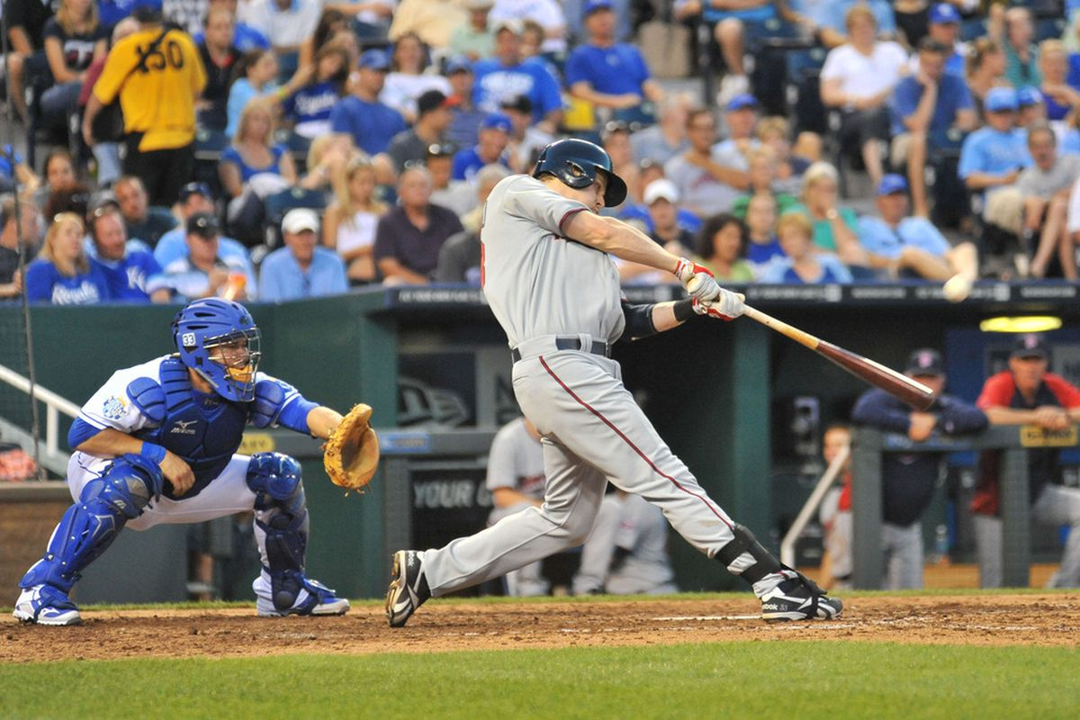 June 04, 2012; Kansas City, MO, USA; Minnesota Twins first baseman Justin Morneau (33) connects for a home run in the fifth inning of the game against the Kansas City Royals at Kauffman Stadium. Mandatory Credit: Denny Medley-US PRESSWIRE