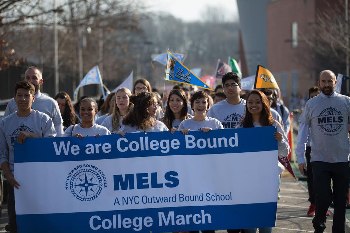MELS students marched last December to celebrate their college acceptances.