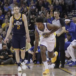 Golden State Warriors guard Nick Young, right, celebrates after scoring in front of Utah Jazz forward Joe Ingles (2) during the second half of an NBA basketball game in Oakland, Calif., Wednesday, Dec. 27, 2017. The Warriors won 126-101. (AP Photo/Jeff Chiu)