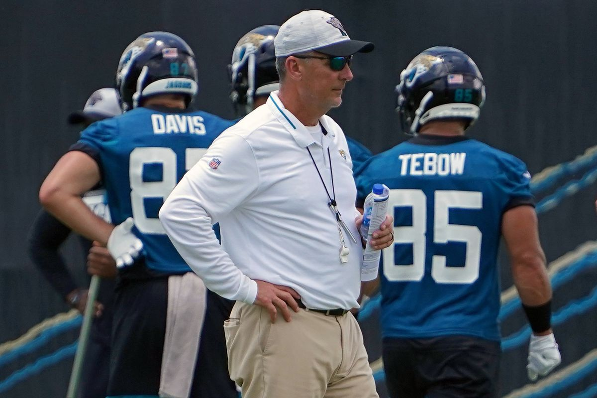 Jacksonville Jaguars head coach Urban Meyer looks on as tight end Tim Tebow (85) and tight end Tyler Davis (87) participate in OTA at the Dream Finders Homes Practice Complex.