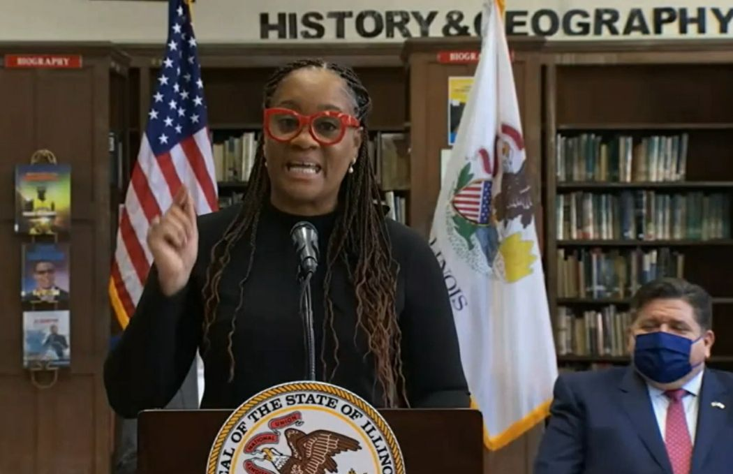 State Senate Majority Leader Kimberly Lightford, D-Maywood, discusses the bill at Monday's bill signing at Proviso East High School.