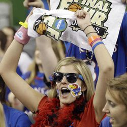 Kansas fan Jacki McCullough cheers before the NCAA Final Four tournament college basketball championship game between Kentucky and Kansas Monday, April 2, 2012, in New Orleans.