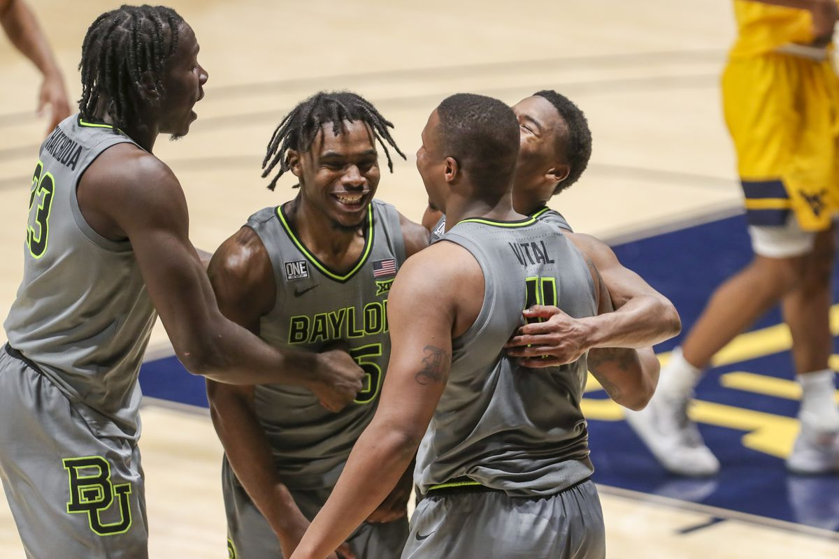 Baylor Bears guard Mark Vital celebrates with teammates after defeating the West Virginia Mountaineers in overtime at WVU Coliseum.