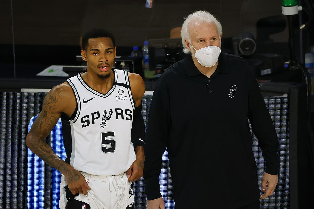 Gregg Popovich of the San Antonio Spurs talks with Dejounte Murray of the San Antonio Spurs during the first quarter against the Utah Jazz at The Field House at ESPN Wide World Of Sports Complex on August 13, 2020 in Lake Buena Vista, Florida.