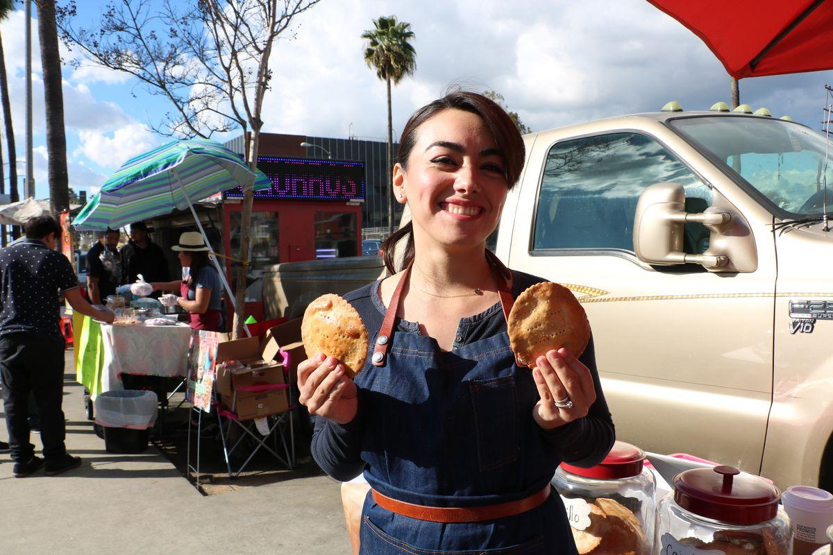 Marisela Parada holding coyotas in East Los Angeles