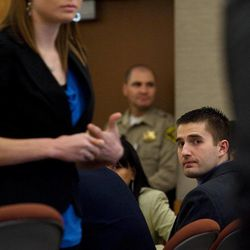Martin Bond turns to look at his ex-wife Rachel Bingham who testified on the first day of his trial in 4th District Court in American Fork Wednesday, Jan. 16, 2013. Bond is accused of killing former BYU professor Kay Mortensen in November 2009.