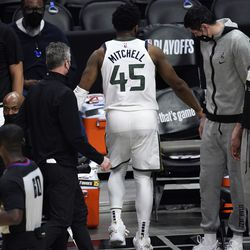 Utah Jazz guard Donovan Mitchell walks off the court with an injury during the second half of Game 3 of a second-round NBA basketball playoff series against the Los Angeles Clippers Saturday, June 12, 2021, in Los Angeles.