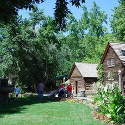 Green, shady lawns, benches and an overall peacefulness often attract Lagoon patrons to Pioneer Village.
