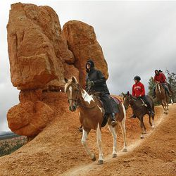 Dean Bradshaw, astride Barack, leads a group past amazing formations on the Thunder Mountain trail.Dean Bradshaw, astride Barack, leads a group past amazing formations on the Thunder Mountain trail.