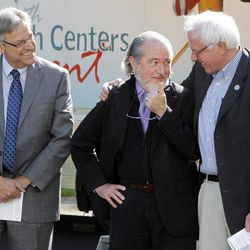 U.S. Sen. Bernie Sanders, right, and Dr. John Matthew, director of the Plainfield Health Center, center, talk during a dedication ceremony on Monday, Sept. 17, 2012 in Plainfield, Vt.  In the past decade, Vermont has gone from having two Federally Qualified Health Centers to eight, including 47 sites where more than 120,000 Vermonters get primary health care, dental care, mental health counseling and low-cost prescription drugs. At left is David Reynolds, Deputy Commissioner of the state Health Care Administration.