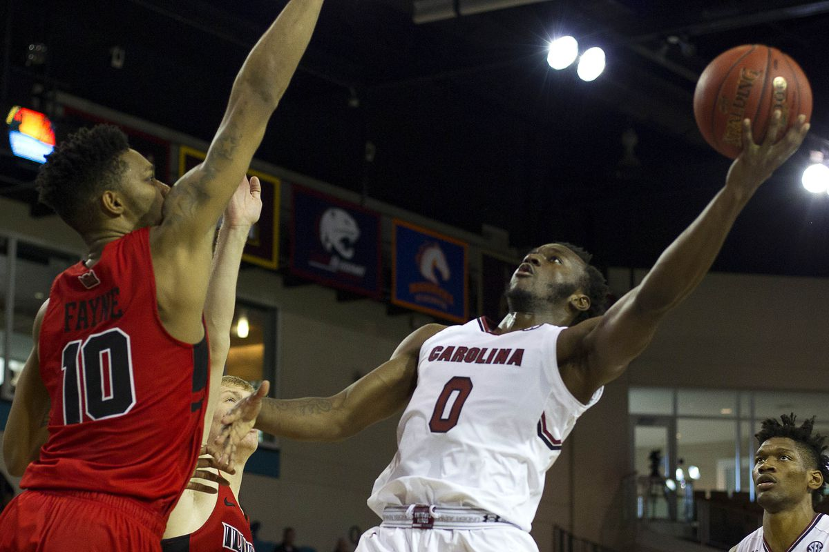 Nov 16, 2017; Conway, SC, USA; South Carolina Gamecocks guard David Beatty (0) attempts the layup while defended by Illinois State Redbirds forward Phil Fayne (10) during the second half of the game at The HTC Center. Illinois State Redbirds won 69-65. Mandatory Credit: Joshua S. Kelly-USA TODAY Sports