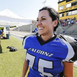 Utah Falconz owner and player Hiroko Jolley watches the game against the Sacramento Sirens in Murray on June 27, 2015. The Falconz compete in a women's tackle football league.