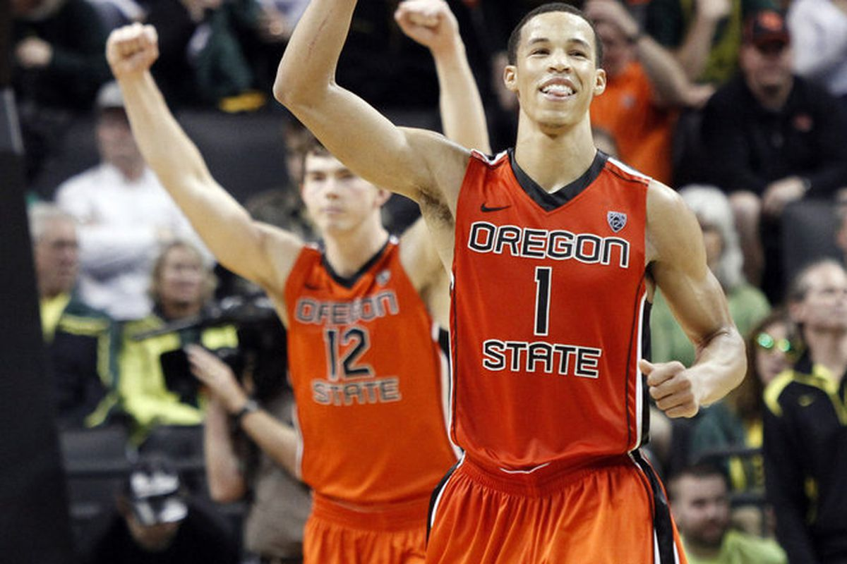 Jared Cunningham, who scored 24 of his game high 27 points in the second half to lead Oregon St.'s rally, and Angus Brandt, celebrate the Beavers' come from behind 76-71 win over Oregon in the 336th. Civil War. <em>(AP Photo)</em>