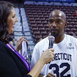 Kara Wolters interviews Richard Hamilton during a timeout.
