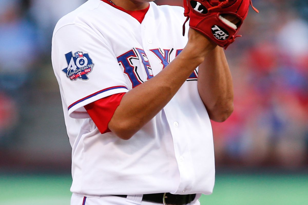 July 24, 2012; Arlington, TX, USA; Texas Rangers starting pitcher Martin Perez (33) throws to the Boston Red Sox in the first inning at Rangers Ballpark in Arlington. Mandatory Credit: Jim Cowsert-US PRESSWIRE