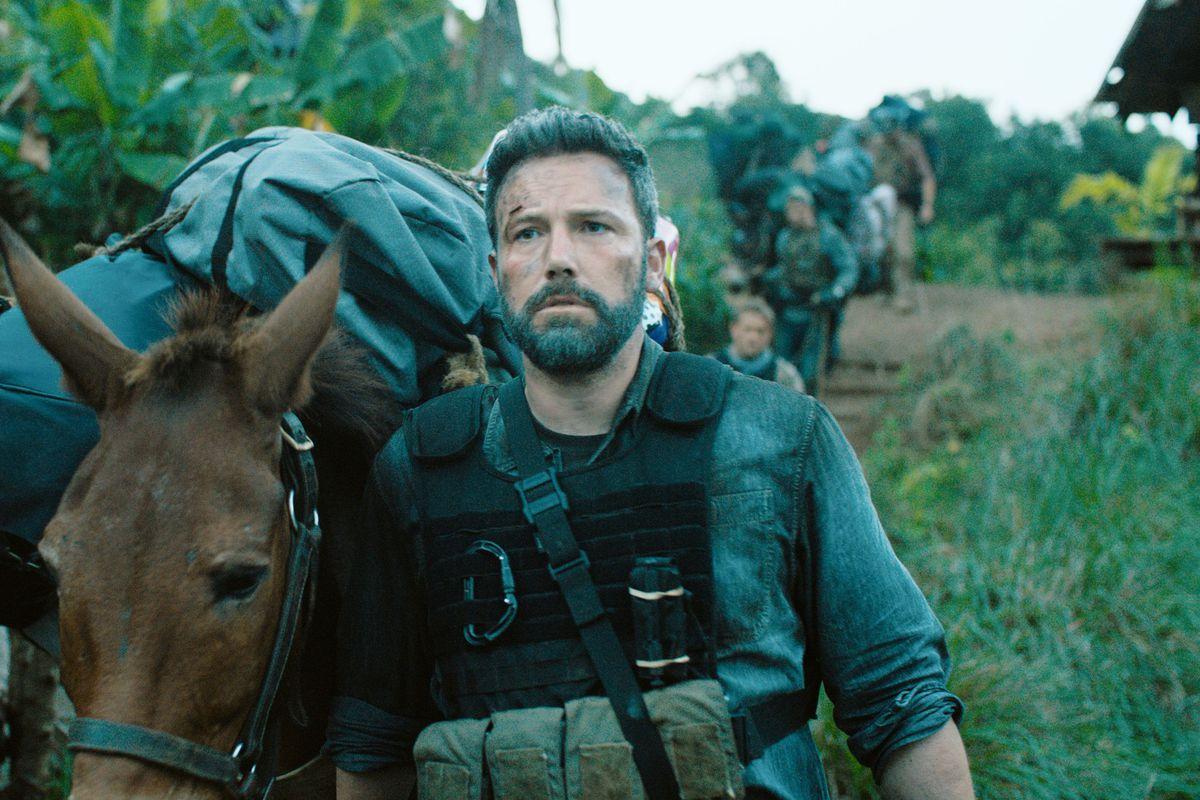 Ben Affleck walking alongside a horse in 'Triple Frontier'