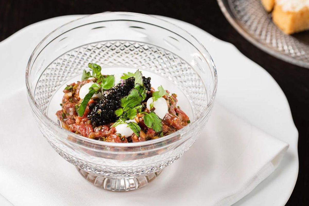Steak tartare with caviar in a glass bowl at Jason Atherton's The Betterment