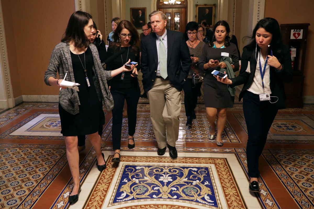 Sen. Lindsey Graham talks with reporters on Capitol Hill in September 2018.