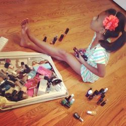 My little beauty-girl-in-training niece, Greysen Glenn, is helping me organize my polishes…and clearly setting aside a few for herself. Smart kid.