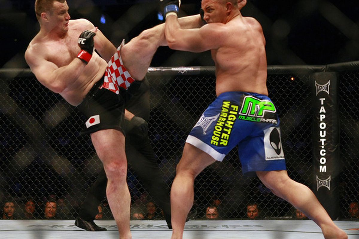 VANCOUVER, CANADA - JUNE 12:   UFC fighter Mirko Cro Cop (L) kicks Pat Barry during UFC 115 at General Motors Place on June 12, 2010 in Vancouver, British Columbia, Canada. (Photo by Jeff Vinnick/Zuffa, LLC via Getty Images)