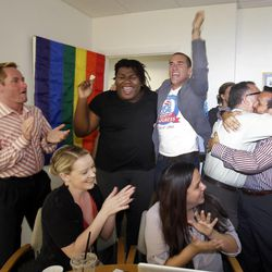 Attendees at a watch party in Miami celebrate after the U.S. Supreme Court's ruling on gay marriage in California Wednesday, June 26, 2013.  The justices issued two 5-4 rulings in their final session of the term. One decision wiped away part of a federal anti-gay marriage law that has kept legally married same-sex couples from receiving tax, health and pension benefits. The other was a technical legal ruling that said nothing at all about same-sex marriage, but left in place a trial court's declaration that California's Proposition 8 is unconstitutional. (AP Photo/Wilfredo Lee)