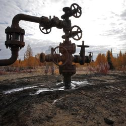 This Saturday, Sept. 10, 2011 photo shows an oil spill near the town of Usinsk, 1500 kilometers (930 miles) northeast of Moscow. Komi is one of Russia's largest and oldest oil provinces but ruptures in aging pipelines and leaks from decommissioned oil wells make oil spills in the region routine. (AP Photo/Dmitry Lovetsky) PHOTO MADE WITH LONG EXPOSURE