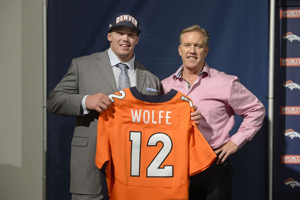 April 28 2012; Englewood, CO, USA; Denver Broncos executive vice president of football operations John Elway (right) and second round draft pick Derek Wolfe pose for the media at Broncos headquarters. Mandatory Credit: Ron Chenoy-US PRESSWIRE