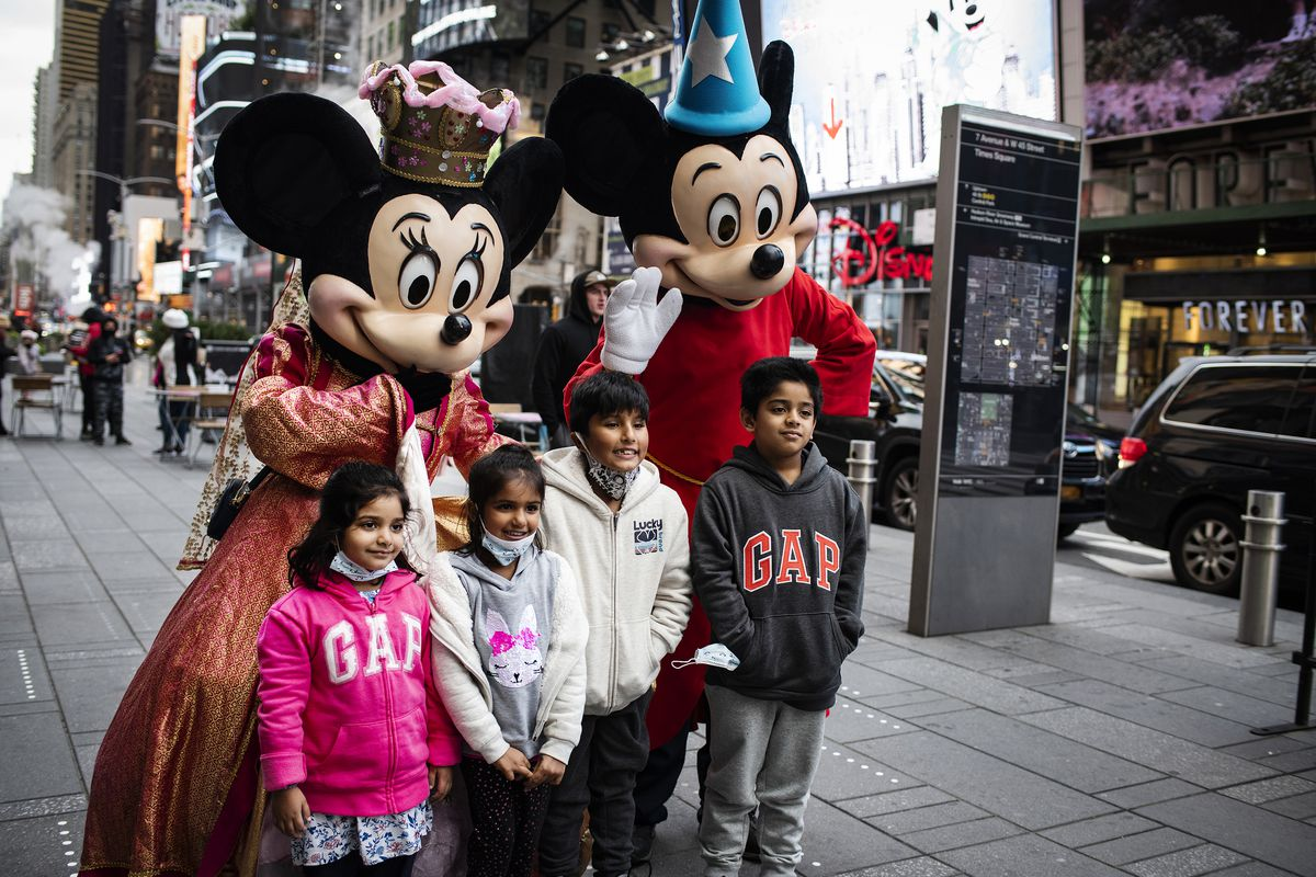 José and Nadia worked together to pose with families last fall, including this one from Queens. Shortly thereafter, shifts in Times Square forced the two to make big decisions on their future.