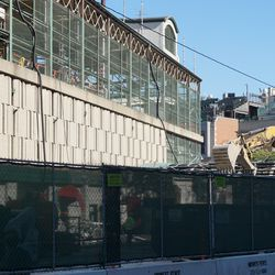 The Draft Kings Sports Zone being demolished, at the corner of Addison and Sheffield