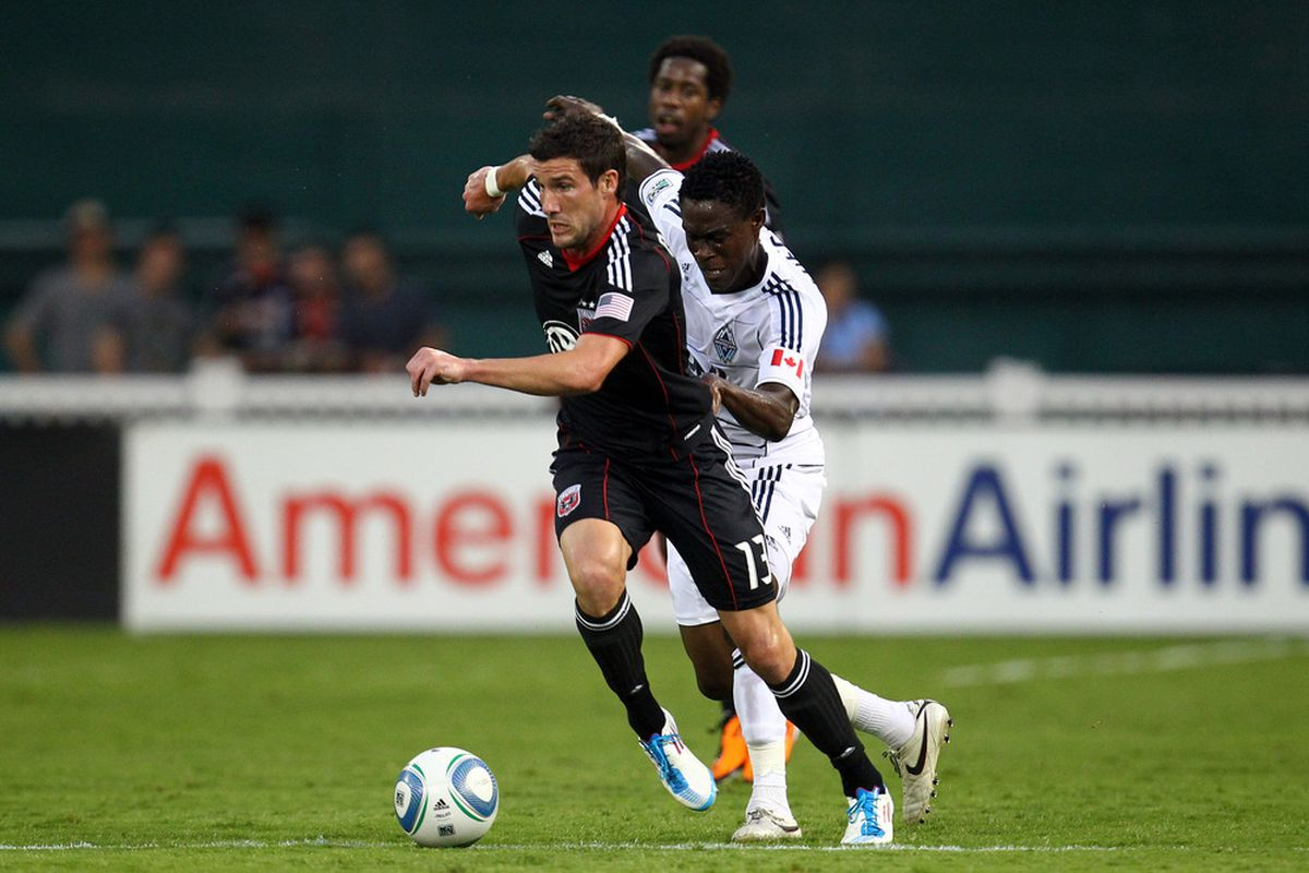 WASHINGTON, DC - AUGUST 13: Chris Pontius #13 of D.C. United controls the ball against Gershon Koffie #18 of Vancouver Whitecaps FC at RFK Stadium on August 13, 2011 in Washington, DC. (Photo by Ned Dishman/Getty Images)