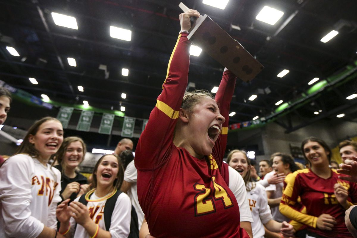 Mountain View's Kaylee Sinema (24) cheers with her team as she hoists the state championship trophy following the 5A high school state finals match at the UCCU Center on the Utah Valley University campus in Orem on Saturday, Nov. 9, 2019.