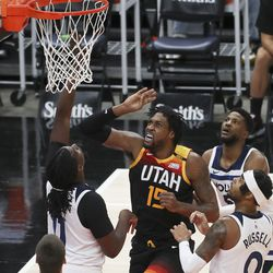 Utah Jazz center Derrick Favors (15) scores against the Minnesota Timberwolves in Salt Lake City on Saturday, Dec. 26, 2020.