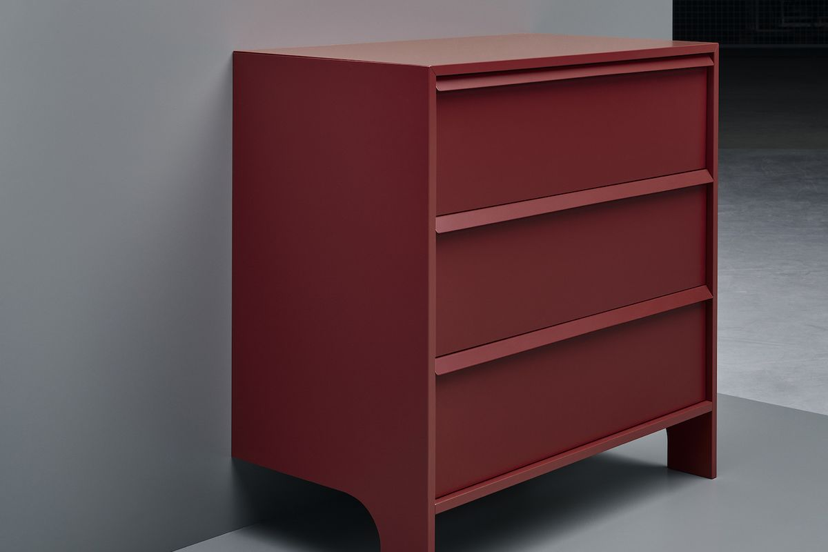 Red dresser against wall