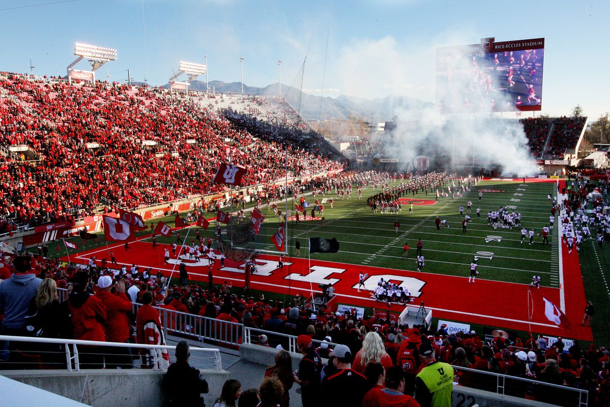 The Utah Utes run onto the field before a college football game against Washington State at Rice-Eccles Stadium.