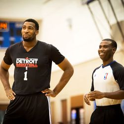 Andre Drummond jokes with a referee