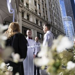 David Gombert and Shaun Airey stand at the altar outside the Wrigley Building on N Michigan Ave during the Meet Me on The Mile Sunday Spectacle Sunday, Sept. 26, 2021. 50 couples were married outside the Wrigley Building during The Mile Sunday Spectacle. | Anthony Vazquez/Sun-Times